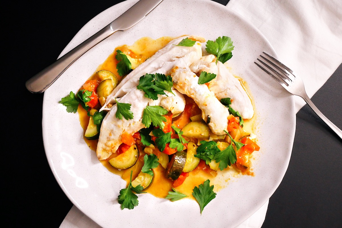 Fish and vegetables cooked in one pan.